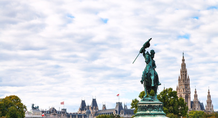 archduke: travel to Vienna city - statue of Archduke Charles on Heldenplatz square and towers of Rathaus in Vienna, Austria Stock Photo