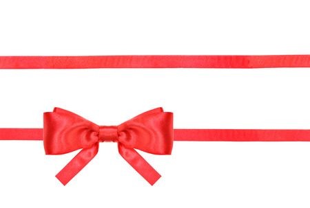 red tie: one red satin bow in lower left corner and two horizontal ribbons isolated on horizontal white background