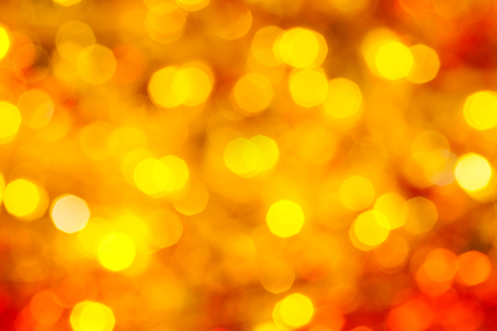 abstract blurred background - yellow and red flickering Xmas lights bokeh of garlands on Christmas tree