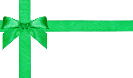 cross ties: one big green bow knot on two crossing satin bands isolated on white background