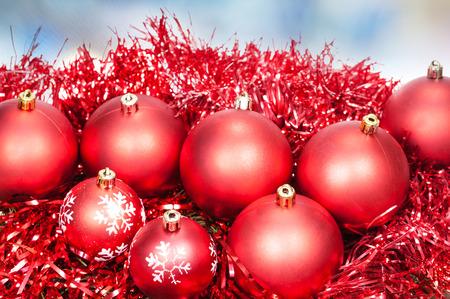 blue christmas lights: Xmas still life - red balls, tinsel with blue Christmas lights bokeh background