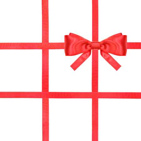 four in one: one red satin bow in upper right corner and four intersecting ribbons isolated on square white background