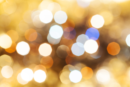 agleam: abstract blurred background - blue and brown shimmering Christmas lights bokeh of electric garlands on Xmas tree