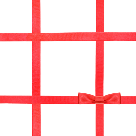 box: one red satin bow knot in lower right corner and four intersecting ribbons isolated on square white background Stock Photo