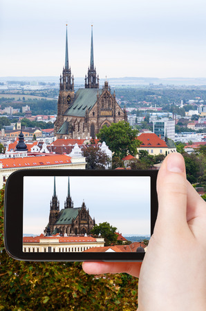 snapshot: travel concept - tourist snapshot of Cathedral of St Peter and Paul in Brno city on smartphone Stock Photo
