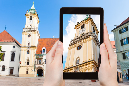 old town hall: travel concept - tourist snapshot of Old Town Hall at Main Square in Bratislava on tablet pc