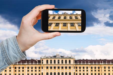 schloss schonbrunn: travel concept - tourist snapshot of facade Schloss Schonbrunn palace in Vienna on smartphone