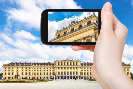 schloss schonbrunn: travel concept - tourist snapshot of Schloss Schonbrunn palace in Vienna on smartphone Editorial