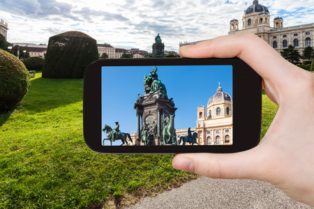 empress: travel concept - tourist snapshot of Empress Maria Theresa statue on Maria Theresien square in Vienna on smartphone