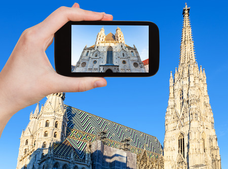 snapshot: travel concept - tourist snapshot of Stephansdom (St. Stephens Cathedral) in Vienna on smartphone