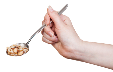 beans soup: hand holding spoon with beans soup isolated on white background Stock Photo