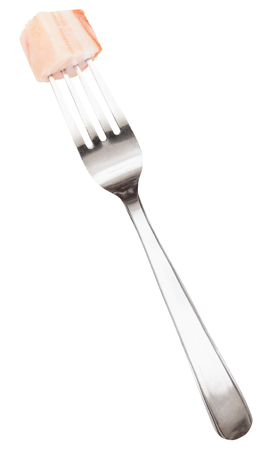 pancetta cubetti: dinning fork with impaled piece of lard isolated on white background