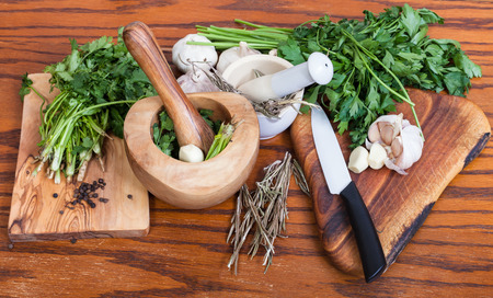 seasonings: cooking seasonings - mortars and spicy ingredients on wooden table