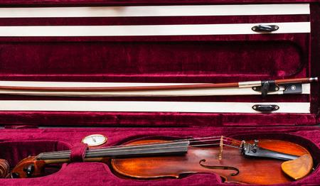 hygrometer: old wooden violin with bow in red velvet case