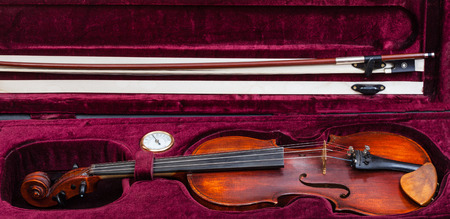 hygrometer: old wooden fiddle with bow in red velvet case