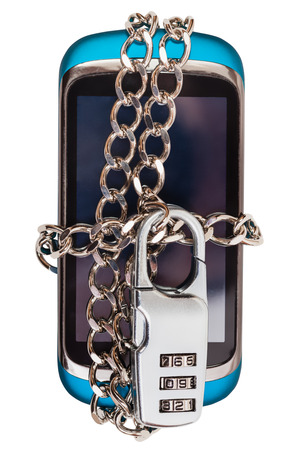 fetter: mobile phone wrapped by chain and closed by combination lock Stock Photo
