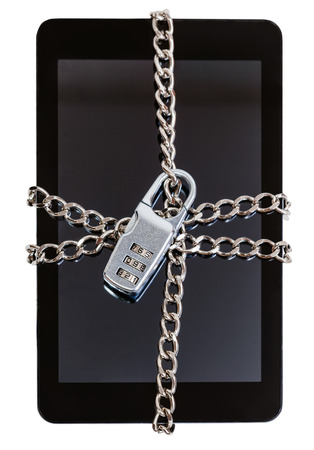 fettered: tablet pc fettered by chain and closed by combination lock