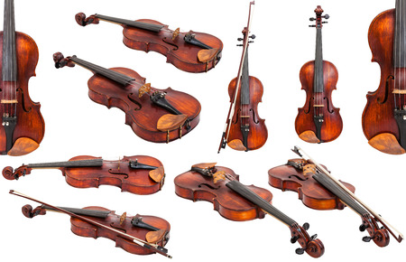 transitional: set of old fiddles isolated on white background