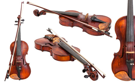 transitional: set of old violins with bows isolated on white background