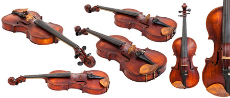 violins: set of old violins isolated on white background