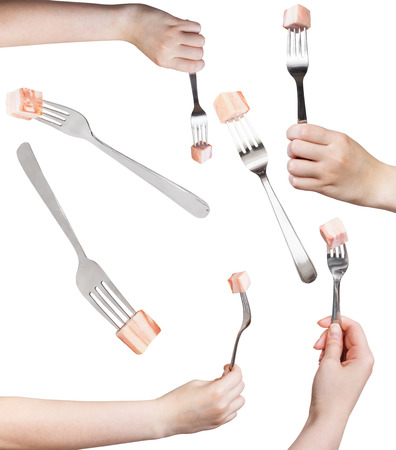 pancetta cubetti: set of dinning forks with impaled piece of lard isolated on white background