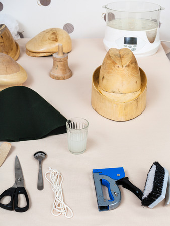 workshop for alpine felt hat making - tools and equipment for hatmaking on table