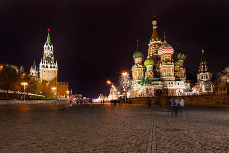 spasskaya: Spasskaya tower of Kremlin and cathedral on Vasilevsky Descent of Red Square in Moscow in night Stock Photo