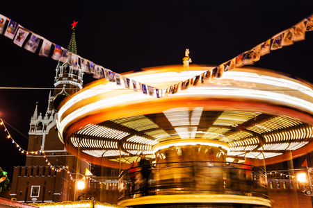 turnabout: illuminated merry-go-round carousel on Red Square on Moscow Christmas Fair