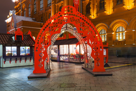 large doors: MOSCOW, RUSSIA - DECEMBER 6, 2015: doors of Christmas Fair on Manezhnaya Square in Moscow in night. Manege Square is a large pedestrian open space in the Tverskoy District, in the center of city