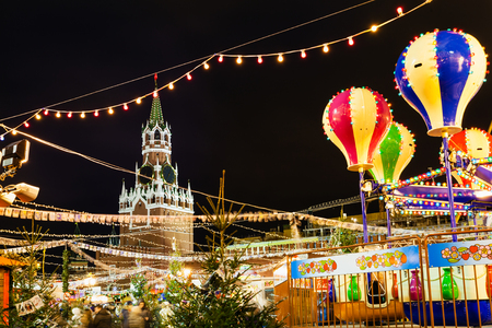 turnabout: MOSCOW, RUSSIA - DECEMBER 6, 2015: Spasskaya Tower and Christmas Fair on Red Square in Moscow in night. Red Square is the central historical square in Moscow.