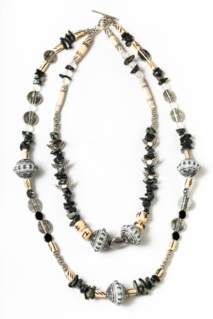 coquina: necklace from coquina, beads, acrylic, rhinestone, bone, metal beads on white background