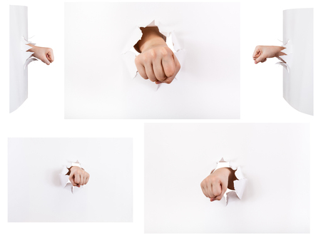 orifice: set of the fists punched a paper wall isolated on white background Stock Photo