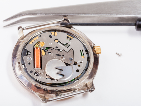 replacing: Repairing of watch - tools and replacing battery in quartz watch close up