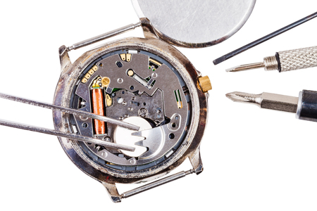 replacing: Repairing of watch - top view of replacing battery in quartz watch isolated on white background Stock Photo