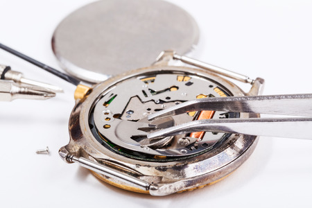 replacing: Repairing of watch - replacing battery in quartz watch close up