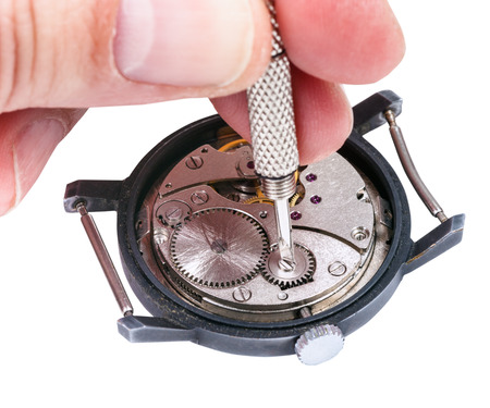 repairer: adjusting old mechanic wristwatch - watch repairer repairs old watch isolated on white background Stock Photo