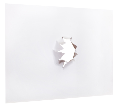 orifice: sheet of paper with punched hole isolated on white background Stock Photo