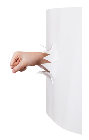 orifice: side view of the fist punches a paper wall isolated on white background Stock Photo