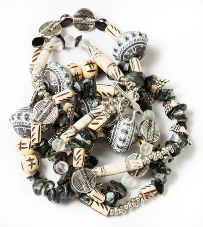 rhinestone: tangled necklace from coquina, beads, acrylic, rhinestone, bone, metal beads on white background