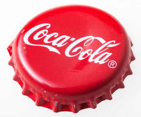 coke bottle: MOSCOW, RUSSIA - DECEMBER 12, 2105: Used red cap from the glass bottle of Coca-Cola. The Coca-Cola Company is an American beverage corporation and manufacturer founded in 1886. Editorial