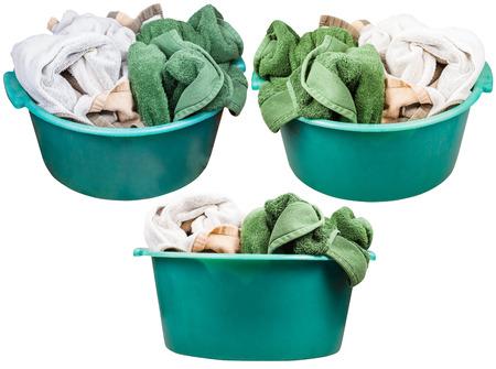 washbasins: set of round green plastic washbasins with towels isolated on white background
