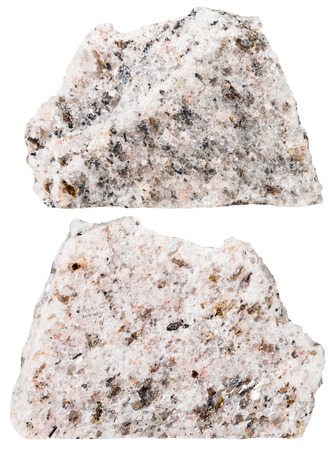schist: macro shooting of specimen natural rock - two pieces of Schist mineral stone isolated on white background