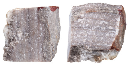 specimen: macro shooting of specimen natural rock - two pieces of Rhyolite mineral stone isolated on white background