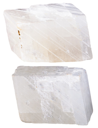 calcite: macro shooting of specimen natural rock - two pieces of white calcite mineral stone isolated on white background Stock Photo