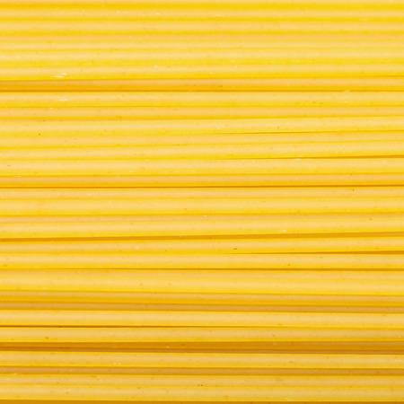 semolina pasta: square food background - durum wheat semolina pasta spaghetti close up