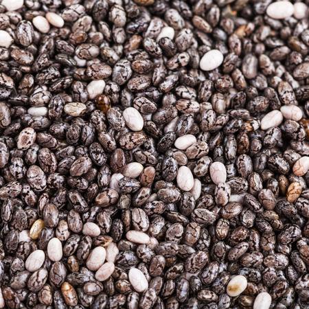 hispanica: square food background - dry seeds of Chia (salvia hispanica) plant close up Stock Photo
