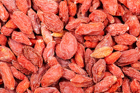 lycium: food background - dried red goji berries close up Stock Photo