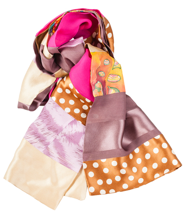 batik: knotted handmade sewing patchwork silk scarf with batik swatch isolated on white background