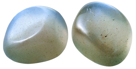 natural mineral gem stone - two Moonstone (adularia, adular) gemstones isolated on white background close up Stock Photo