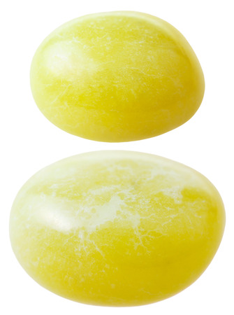 calcite: natural mineral gem stone - two Calcite gemstones isolated on white background close up